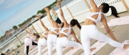 girls doing yoga in same pose