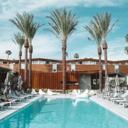 pool in Palm Springs with chairs around it
