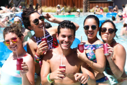 five people enjoying Sofia drink in swimming pool