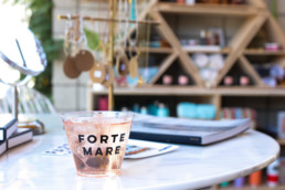 Forte Mare cup with drink inside on table
