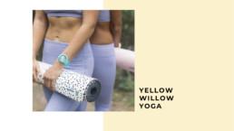 yellow willow yoga model holding mat