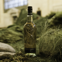 highland park bottle in wilderness