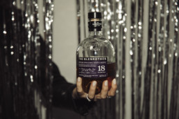 the glenrothes bottle being held