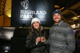 two happy people drinking highland park