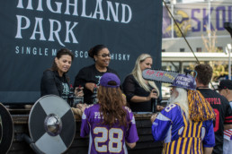 highland park reps giving out samples to viking fans