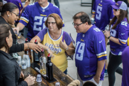 people sampling highland park at vikings game