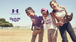 under armor ad with three female baseball players