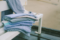 mayde towels on a bench