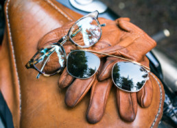 Shwood glasses on leather gloves
