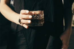 bottle of whiskey in a cup