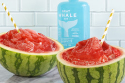 gray whale gin next to watermelon cocktail