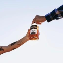 nostros bottle being shared